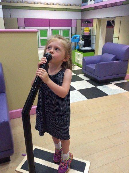 The diva sings karaoke in the Lego Friends area.